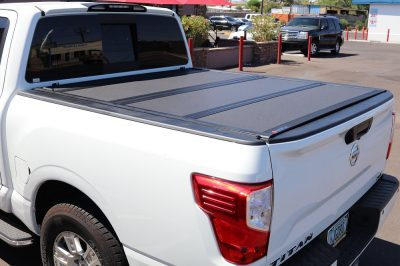nissan titan hard trifold truck bed cover
